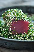 Tuna tataki in a herb and sesame seed coating (Japan)