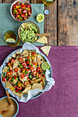 Vegan nachos with guacamole and queso sauce