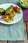 Sweet potato cakes with crispy tofu and pea pesto