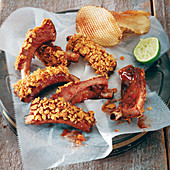 Pork ribs with barbecue sauce and nachos