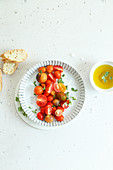 Fresh cherry tomatoes with salt extra virgin olive oil fresh oregano and bread