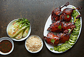 Twice-cooked sticky duck with steamed pak choi