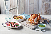 Roast chicken with brown-butter basted radishes and asparagus with salsa verde