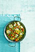 Paella mit geräuchertem Paprika, Kabeljau und Erbsen