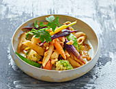 Whole grain pasta with colorful carrots