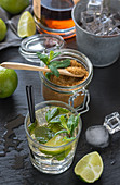 Glass of cold mojito made of rum and lime with peppermint, brown sugar