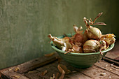Onions in a green ceramic bowl