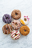 Variety of doughnuts on marble background