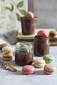 Chocolate mousse in glasses with macarons
