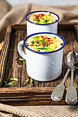 Chicken and corn chowder, served with bacon and chive