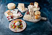 Antipasti: Various types of cheese with fruit and with tomatoes