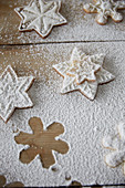 Snowflake cookies with powdered sugar on a wooden table