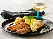 Fried mackerel fillets with herb butter