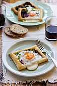 Puff pastry mini tarts with beetroot, egg and chieve, blach pepper, bread, red wine