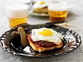 Toast with meat balls and fried egg