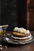 Buckwheat and hazelnut cake with cream cheese cream and acacia honey