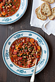 Soup with beans, tomatoes and carrots, bread