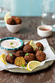 Carrot falafels, yogurt with harissa, lemon wedges