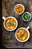 Carrot soup with baked chickpeas, tahini, zaatar and parsley