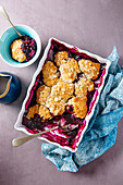 Fresh blueberry cobbler with almonds