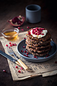 Vegan apple oatmeal pancakes with coconut yoghurt and pomegranate seeds
