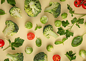 Vegetables food pattern made of broccoli, Brussels sprouts, cucumber, cut tomatoes, herbs