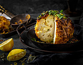 Vegan roast cauliflower with spicy crust and a lemon tahini dressing