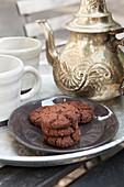 Dark chocolate and fleur de sel cookies with tea