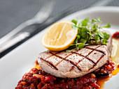 Grilled tuna steak on tomato sauce