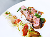 Lamb with pesto and summer vegetables