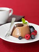 Chocolate panna cotta with fresh berries
