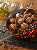 Autumnal meatballs with dried mushrooms and currants