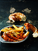 Currywurst with french fries and pretzels