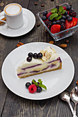 Iced coffee, white chocolate cake with blueberry and black cherries