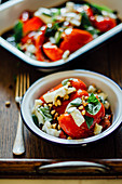 Roasted red peppers basil pine nuts feta cheese balsamic vinigar
