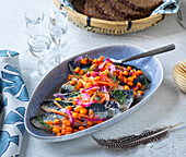 Pickled herring with sea buckthorn and red onions