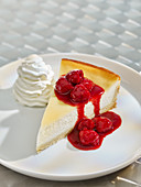 Baked Raspberry Cheesecake with whipped cream