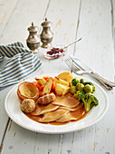 Roast turkey with Yorkshire puddings and vegetables (England)