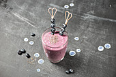 A blueberry smoothie with blueberry skewers