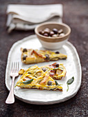 Potato Frittata with bacon, onions and olives