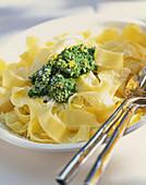 Ribbon pasta with pesto and Parmesan