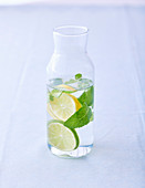 Citrus water with mint in a carafe