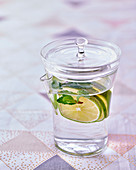 Lime water in a glass with a lid