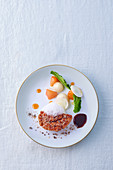Veal sweetbread with vegetables and a frothy sauce