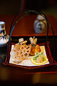 Lotus root slices and fried pastry parcels in 'Matsumi', a Japanese restaurant in Hamburg