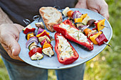 Stuffed pointed peppers with feta cheese and grilled vegetable skewers