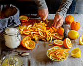 Preparing orange jam: cutting the orange peel into strips