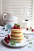 Pancakes with raspberry sauce and mint
