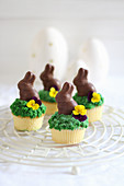 Easter cupcakes decorated with chocolate Easter bunnies