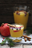 Winter orange punch with cinnamon and fruit